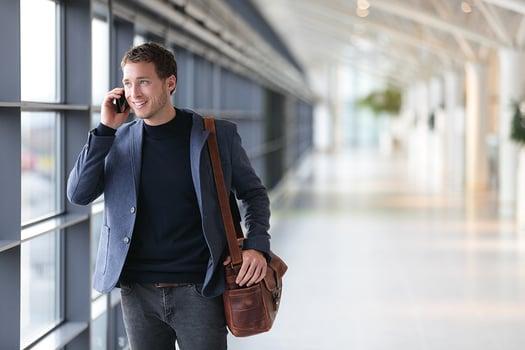 man holding a phone_shutterstock_